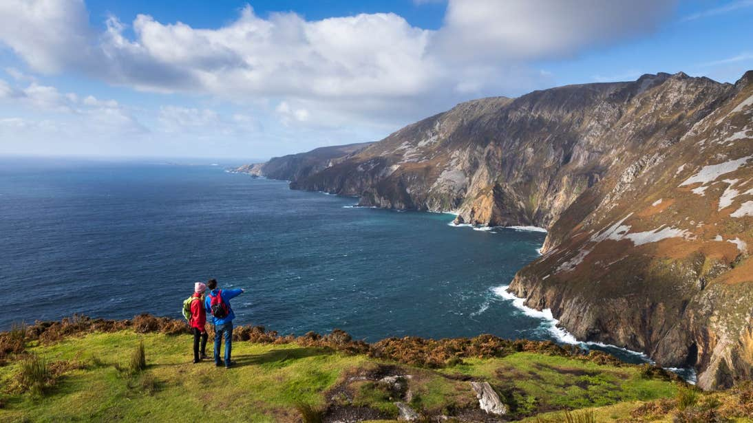 People looking out from Slieve League Cliffs, Donegal