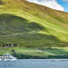 A boat sails through Killary Harbour in County Galway.