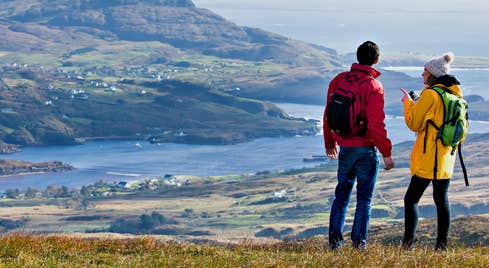 Image a couple hiking on Slieve League in County Donegal