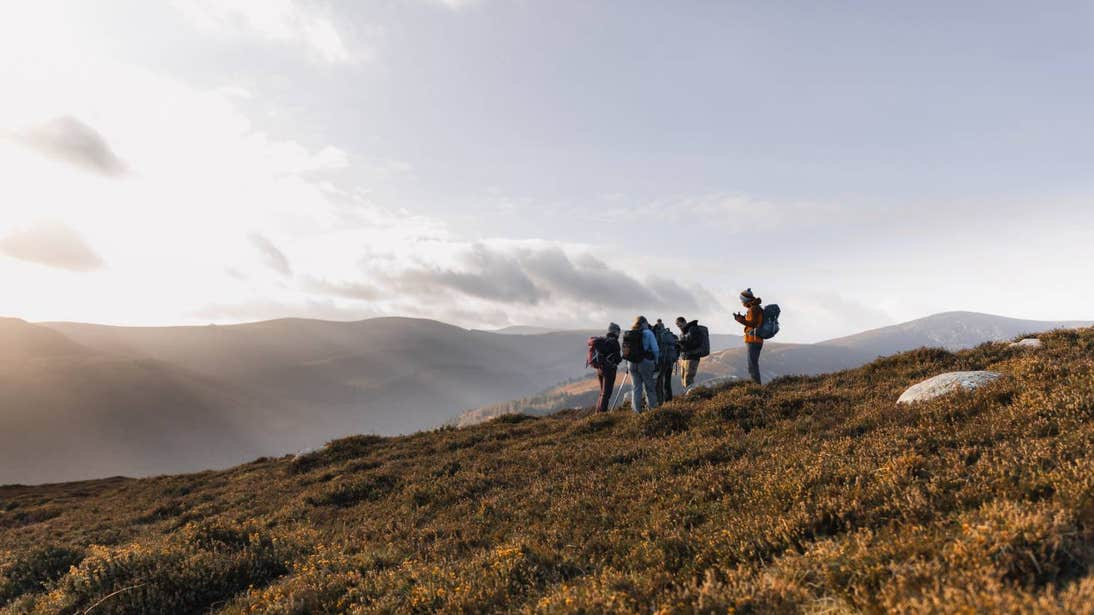 Group of people hiking across Wicklow Mountains National Park on a sunny day