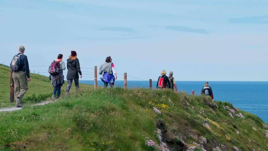 A group of people taking on Doolin Cliff Walk, Clare