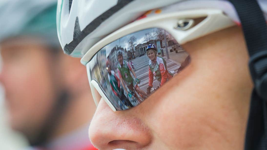A close-up view of cyclists wearing helmets