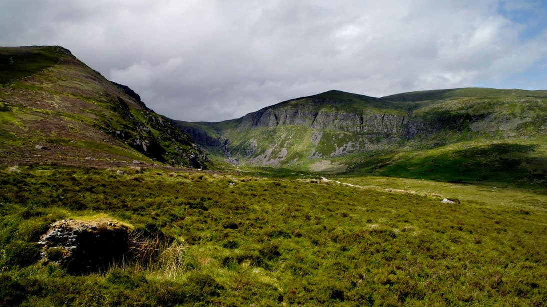 Lush green hills in front of Mahon Falls, County Waterford