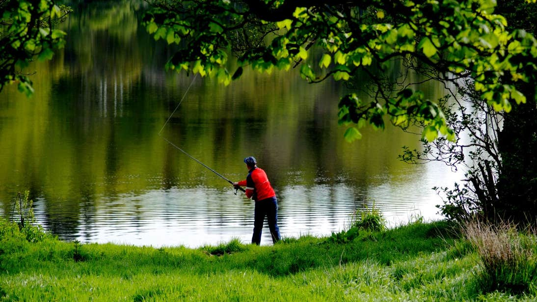 Person in a red t-shirt fishing at Lough Muckno, Monaghan