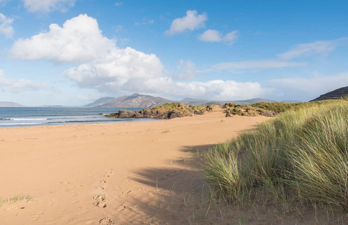 Footprints in the sand leading to the sea at Ballymastocker Beach, Donegal, Wild Atlantic Way.