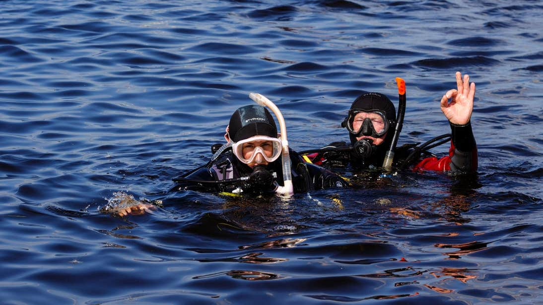 Two people in the water scuba diving at Offshore Watersports in Mullaghmore, Sligo