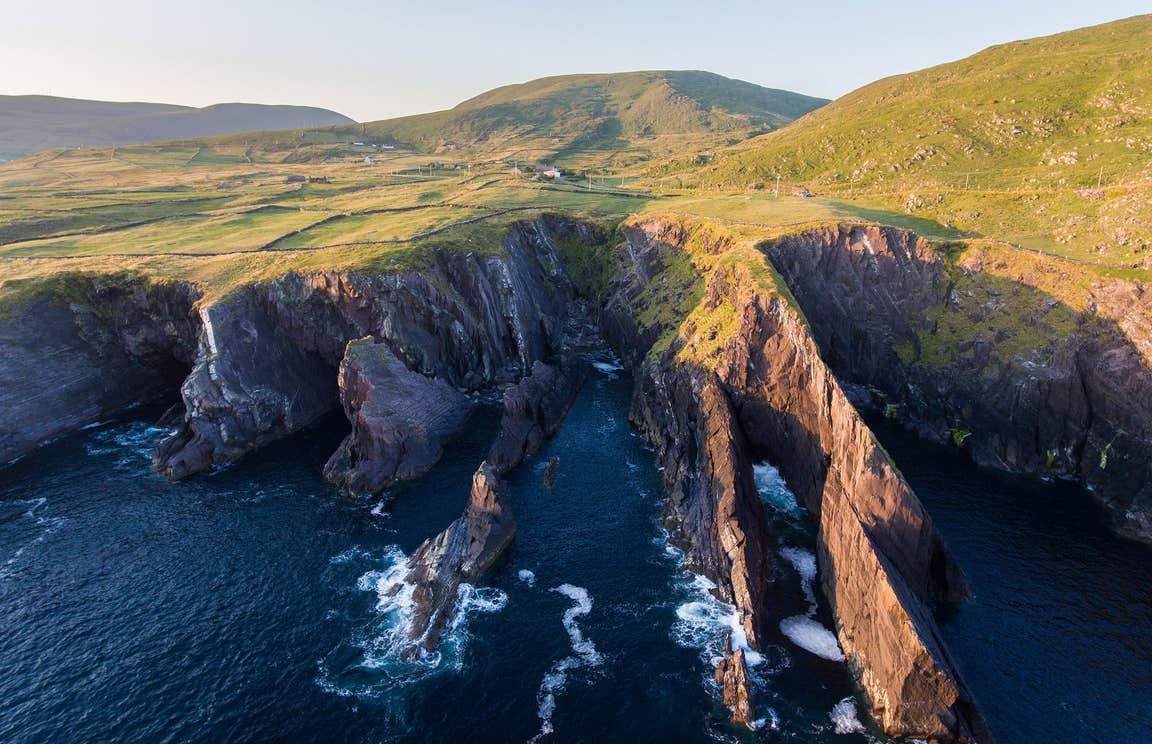 Green fields and cliffs at Skellig Ring, Co. Kerry