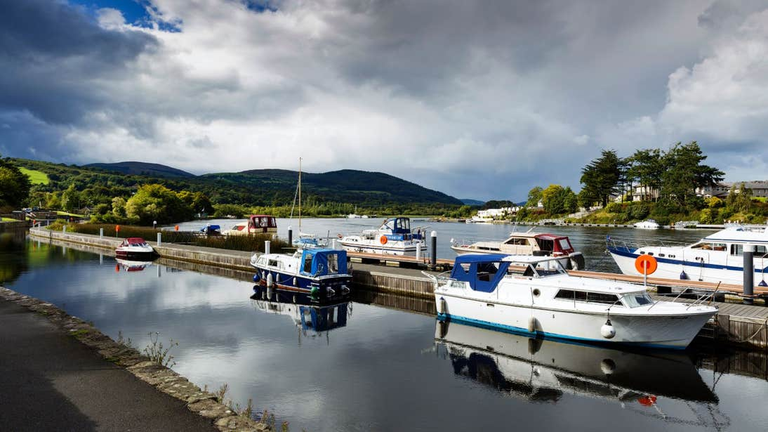 A cloudy blue sky and boats at Killaloe Harbour on the River Shannon