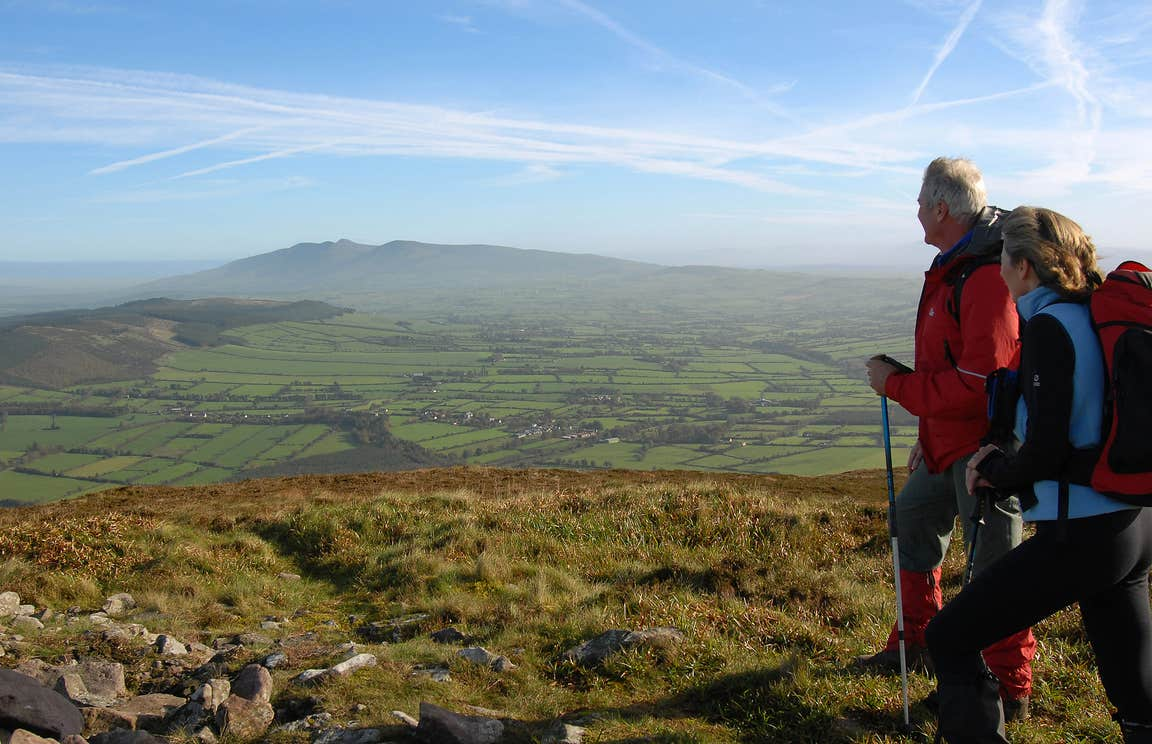 Two Hikers in the Munster Vales on a bright day