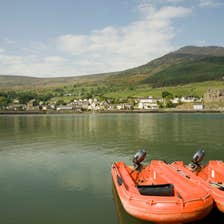 Two orange boats on the water on Carlingford Lough in Louth