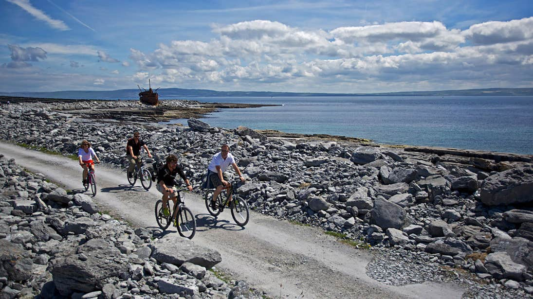 A group of friends cycling on Inisheer, Aran Islands, Galway