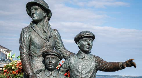 Statue of an emigrant family at the Cobh Heritage Centre – the Emigration & Maritime Story in County Cork.