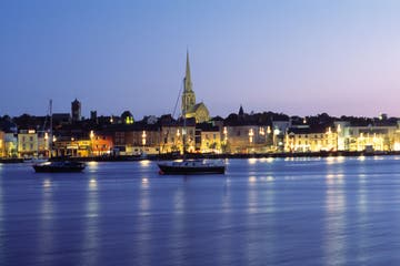 Boats in front of Wexford Town at night in Wexford