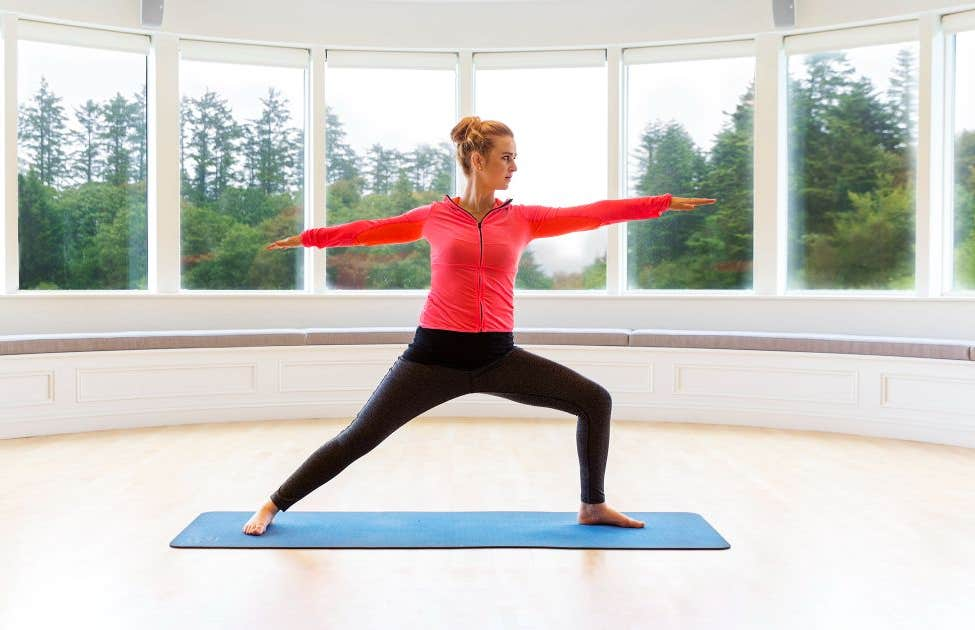 Woman doing yoga by herself at Ballynahinch Castle Hotel in Connemara, Galway