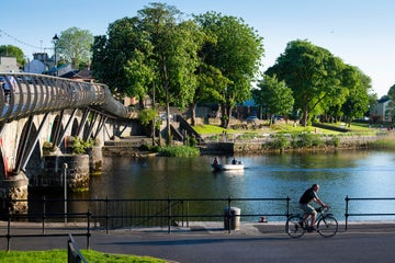 A man cycling beside the River Shannon in Leitrim on a sunny day
