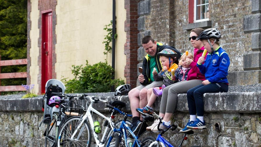 A family enjoying an ice cream break on the Old Rail Trail, Westmeath