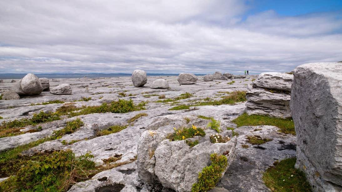 People walking through the karst landscape on Black Head Looped Walk, The Burren, Clare