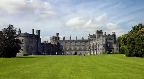 Blue skies and green grass at majestic Kilkenny Castle