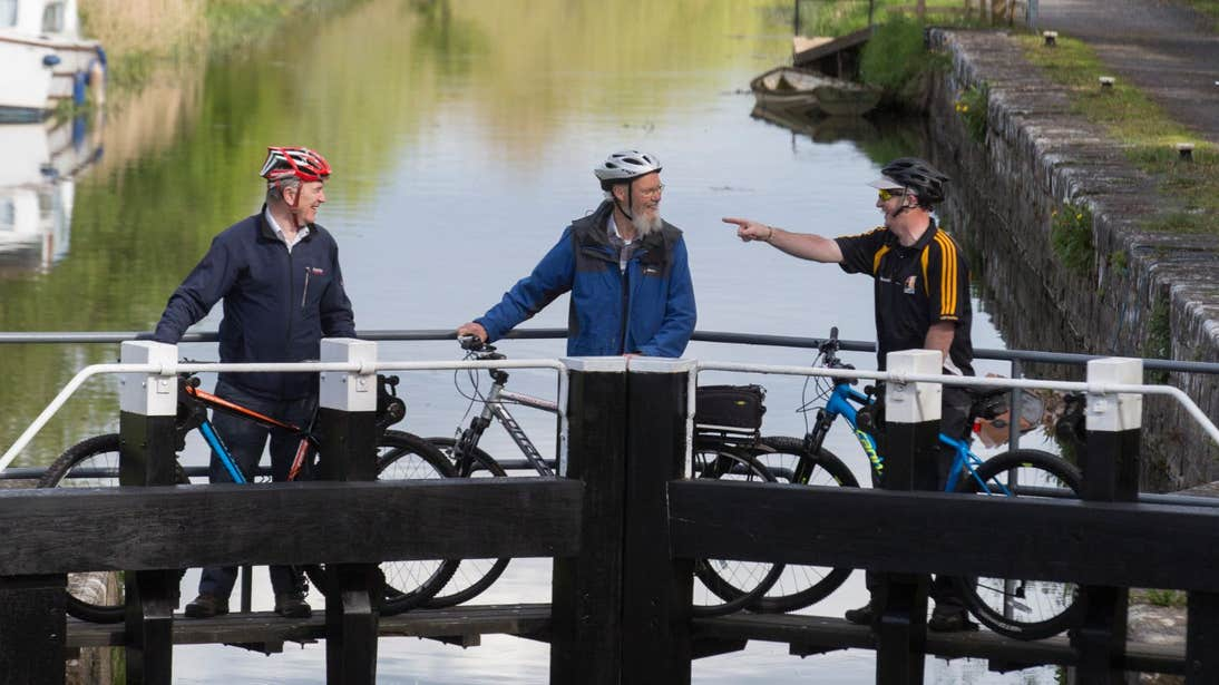Three men with bikes on the Royal Canal Way in Dublin