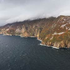 The Slieve League cliffs in Donegal towering above the deep blue sea