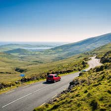Image of a red car on the Conor Pass in Dingle in County Kerry