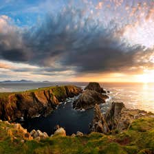 A sunset behind rocks at Malin Head in Donegal