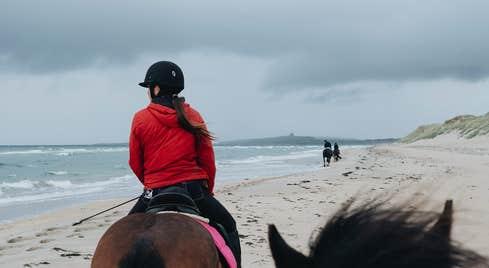 Girl horseriding on the beach