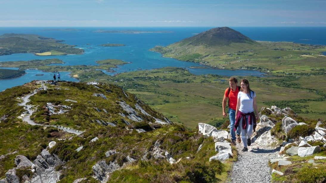 Hikers at Diamond Hill on a sunny day in County Galway