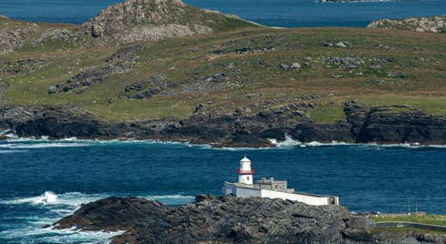 Landscape view of Valentia Island Lighthouse with the sea in the background