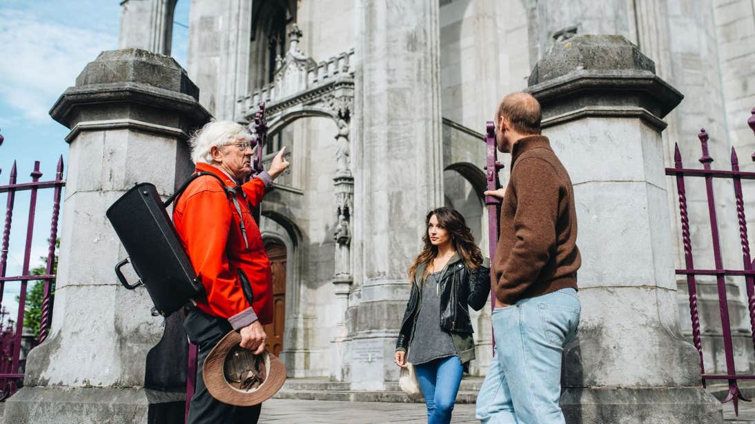 A couple listening to a guide on a Cork City Walking Tours