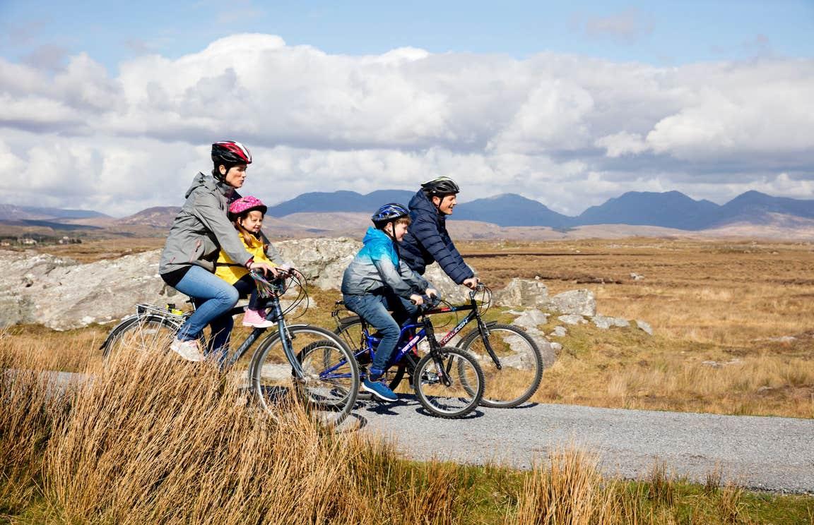 Family cycling through Derrigimlagh, County Galway