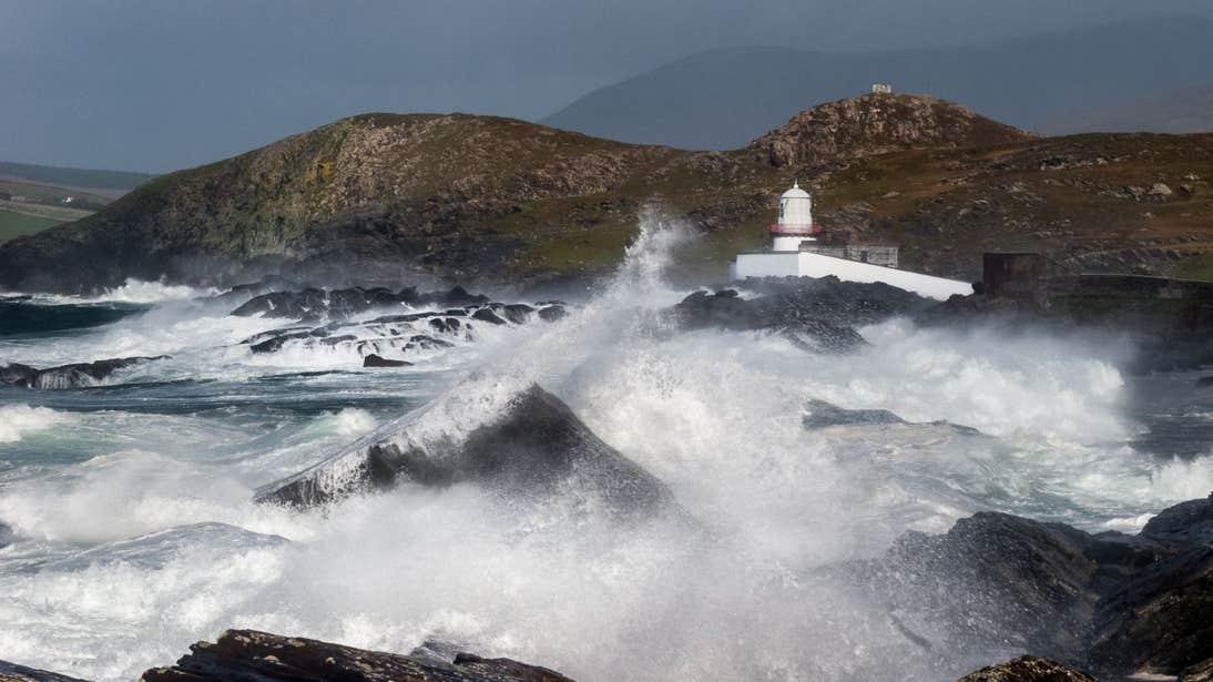 Waves crashing against rocks at Valentia Island Lighthouse, Kerry