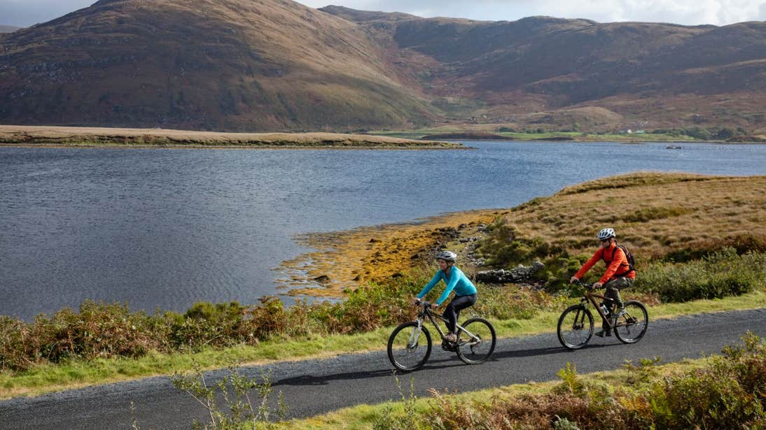 Two people cycling along the Great Western Greenway, County Mayo by water