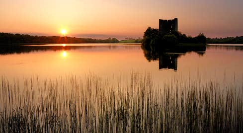 Sun setting over Cloughoughter, County Cavan
