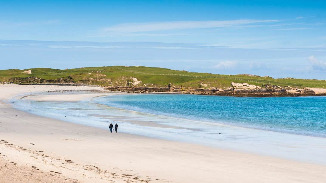 Two people walking on Dog's Bay Beach, Co Galway