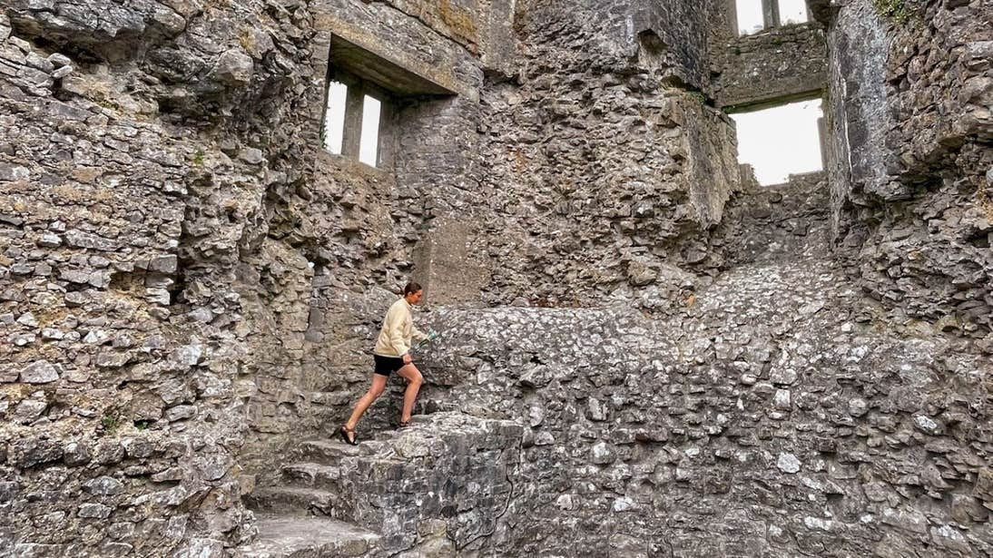 Roz Purcell climbing a stone staircase in Roscommon Castle