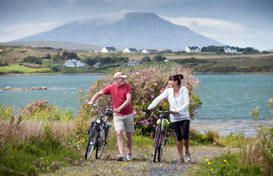 Two cyclists enjoying mountain views on Great Western Greenway, Mayo