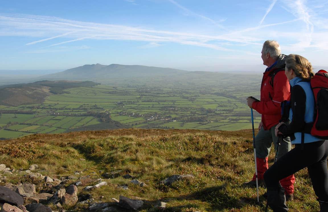 Two people in hiking gear walking Blackrock Loop, Ballyhoura, County Limerick