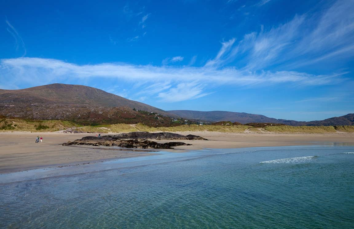 blue skies and a mountain backdrop at Derrynane Beach, Kerry