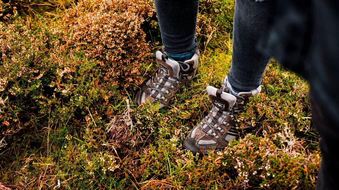 Hiking boots standing on leaves in Wild Nephin Ballycroy National Park