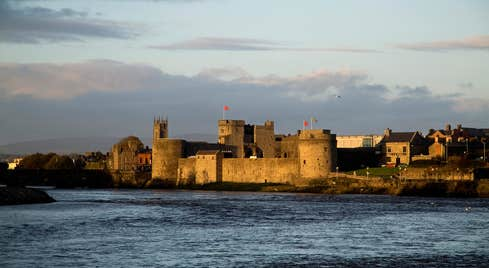 King Johns Castle surrounded by water on a cloudy day in County Limerick