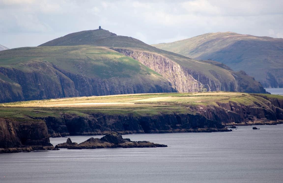 A calm sea surrounding the Dingle Peninsula in County Kerry