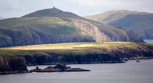 A calm sea surrounding the Dingle Peninsula in County Kerry