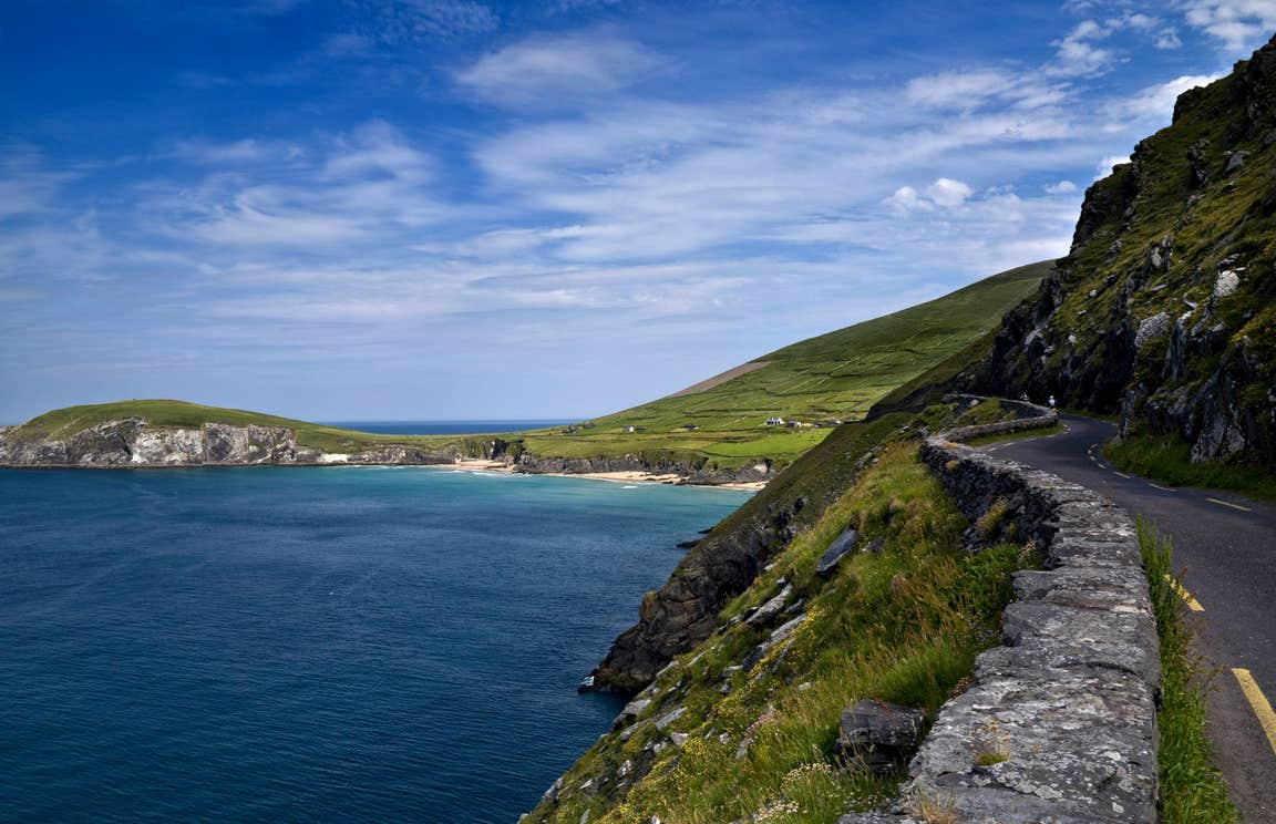A road and stone wall leading to a beach on Slea Head, Dingle, Kerry