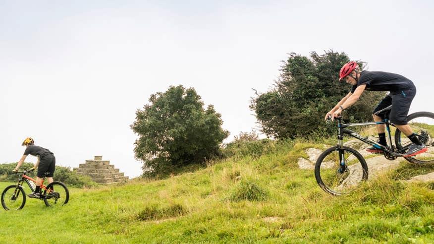 Swap your sleek road bike for a rugged mountain bike.