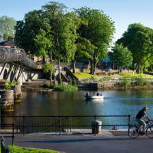 A man cycling on the banks of a river in Carrick-on-Shannon in County Leitrim
