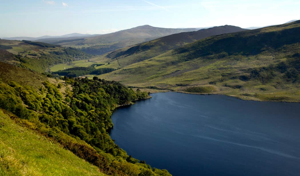 Blue lake set in the middle of rolling green hills in the Wicklow Mountains, Wicklow.