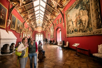 Friends looking at art inside Kilkenny Castle, Kilkenny