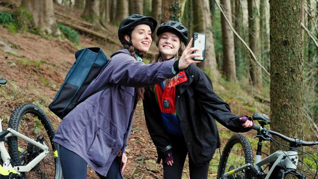 Two women taking a selfie with mountain bikes in Ballyhoura.