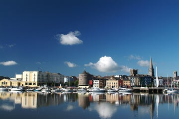 View Of Waterford Quas County Waterford on a sunny day with buildings in the background.